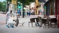 Mann tötet Frau mit Machete und verletzt weitere Menschen