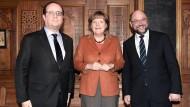 Hollande und Merkel beraten sich
